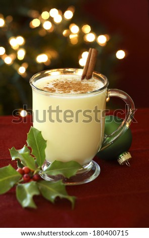 Still life of egg nog and holly  - stock photo