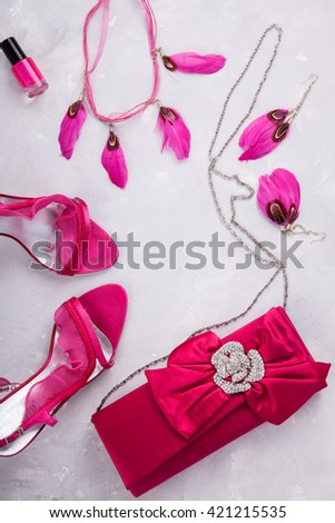 Still life of fashion woman. background.Women's set of fashion accessories in pink color.Shoes with heels and clutch bag.Copy space.selective focus. - stock photo