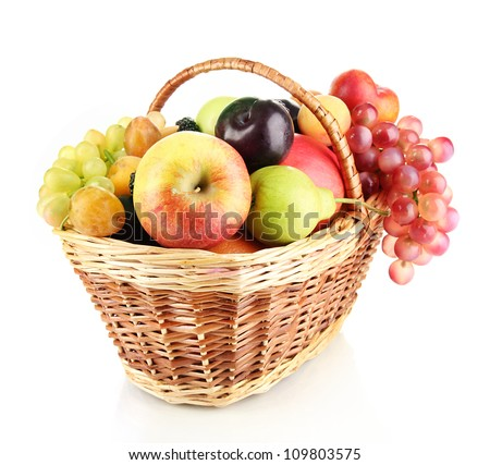 Still life of fruit in basket isolated on white - stock photo