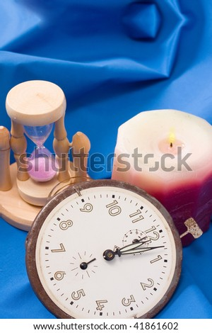 Still life of hourclock, clockwork and candle - stock photo