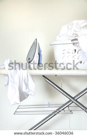 Still life of laundry on ironing board - stock photo