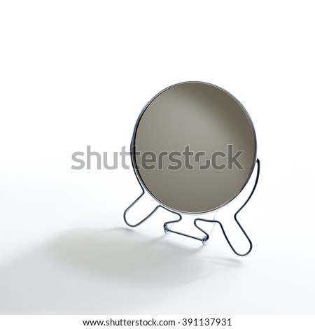 still life of mirror on metal frame placed on white background