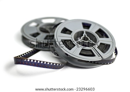 still life of 8mm cine film and reels; isolated on white ground; differential focus - stock photo