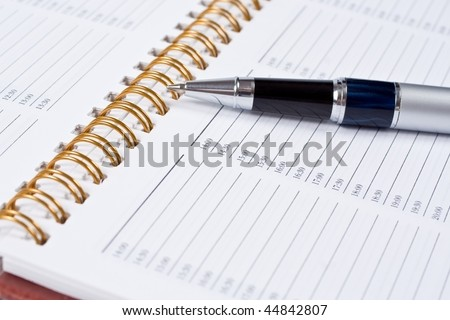 Still-life of pen with a notebook - stock photo