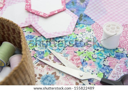 Still Life Of Quilt Making Fabric And Accessories - stock photo