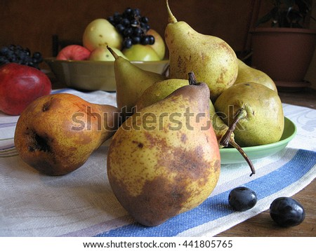 still life of red apples, green pears and grapes on towel.Color photo, rustic style. Ukraine. - stock photo