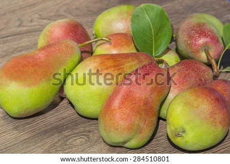 Still life of ripe juicy pears - stock photo