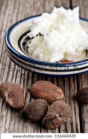Still life of shea butter and nuts, used for cosmetic products and skincare - stock photo