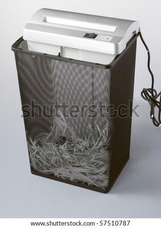 Still life of shredding machine on plain background. - stock photo