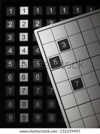 still life of sudoku game - stock photo