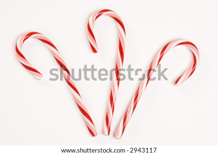 Still life of three candy canes.
