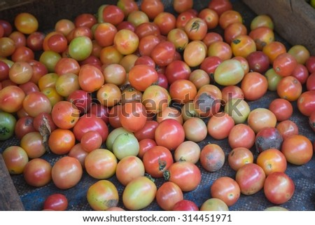 still life of tomatoes in the wood. selective focus point.Different Fruits and vegetables at a street market in asia.