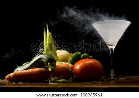 Still life of vegetables and liquid nitrogen - stock photo