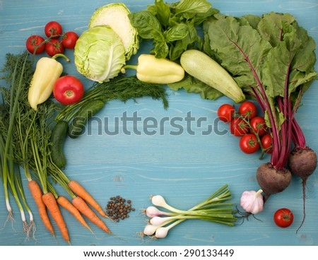 still life of vegetables on a blue wooden background