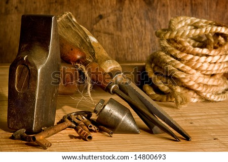 Still-life of vintage carpenter tools and rusty keys - stock photo