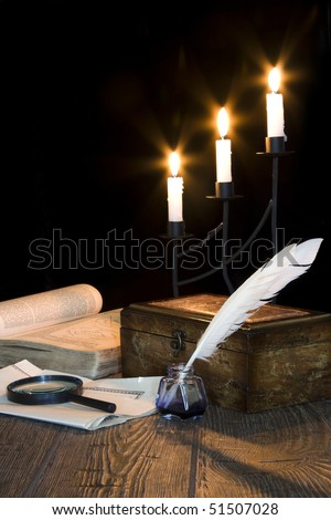 Still life of vintage objects with candle,  trunk and old book - stock photo