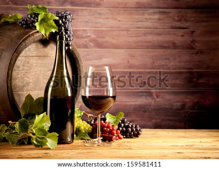 Still life of wine with wooden keg - stock photo