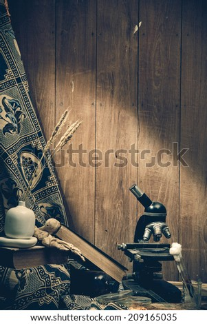 Still life. Old book and Vintage microscope  - stock photo