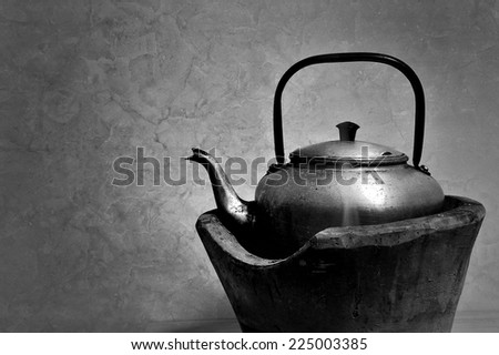 Still life old kettle on a stove  - stock photo