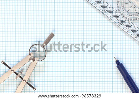 Still life photo of engineering graph paper with a fine 0.1mm pen, compass and protractor ruler, blank to add your own design, image or text. - stock photo