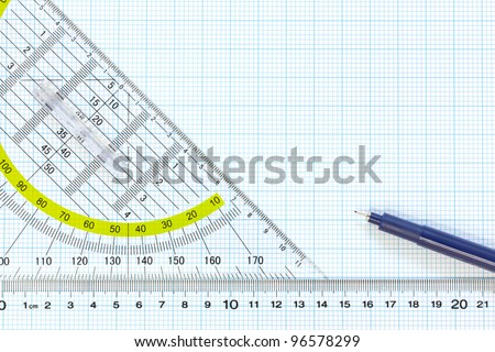 Still life photo of engineering graph paper with a fine 0.1mm pen with ruler and protractor, blank to add your own design, image or text. - stock photo