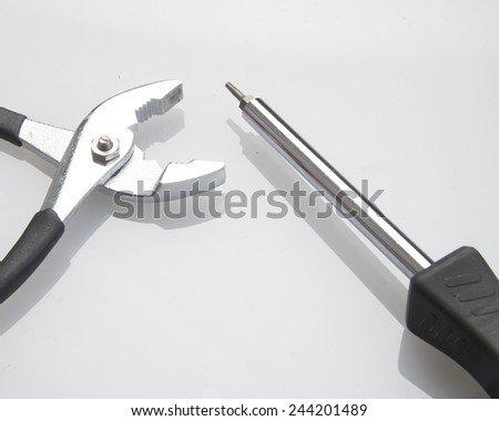 Still life photo of pliers screwdriver and/Working Tools/Array of tools on a surface - stock photo