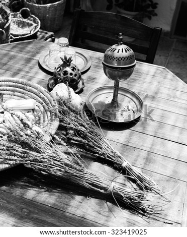 Still life photograph showing two bundles of dried lavender with a metal spice box designed to gradually release the aroma. (Scanned from black and white film.) - stock photo