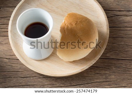Still life photography : Chalice with red wine and bread, symbols of holy communion - stock photo