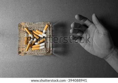 Still life photography , cigarette with ashtray on wood background. stop smoking before too late - stock photo