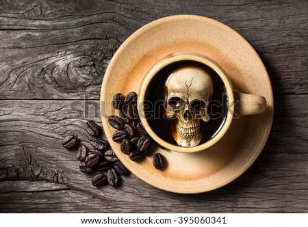 Still life photography : human skull soak in coffee cup in harmful effect from Caffeine concept - stock photo