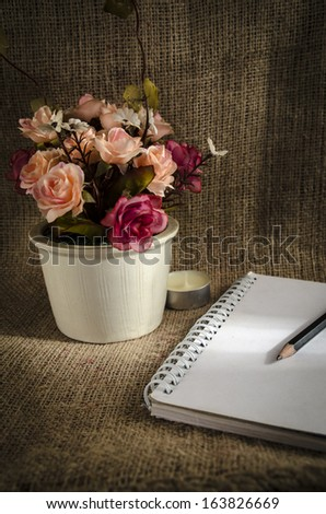 Still life photography. Notebook and flowers. Concept is relaxation - stock photo