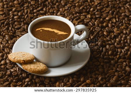 Still life photography of hot coffee beverage with map of Cuba