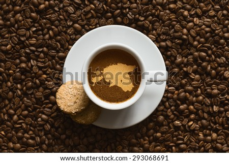 Still life photography of hot coffee beverage with map of Estonia