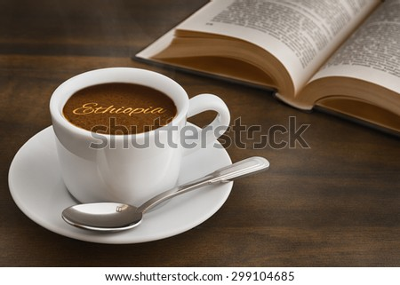 Still life photography of hot coffee beverage with text Ethiopia - stock photo