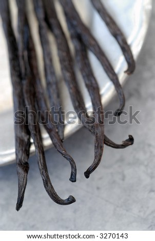 Still life photography of whole vanilla beans. Shallow depth of focus.