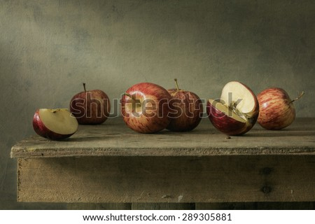 Still life photography with apples on wood table - stock photo