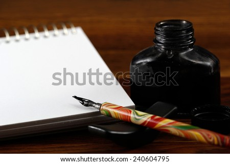 Still life shot of drawing with ink - stock photo