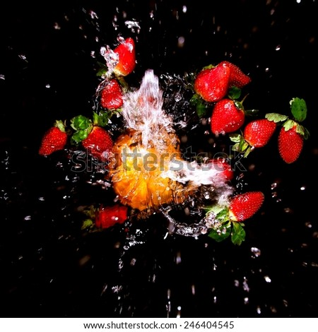 Still Life - splashing water on black background   - stock photo