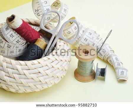 Still-life various accessories of sewing in a basket - stock photo