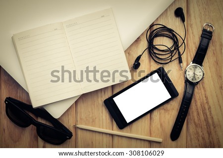 Still life vintage image with laptop computer, mobile phone, sun glasses, watch and notebook with pencil, Still life with man casual and computer, Vintage still life photography - stock photo