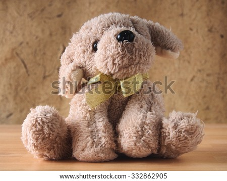 Still life vintage tone,Cute dog brown doll/toy on wood - stock photo