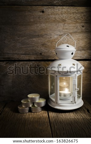 Still life.White lantern with scented candles