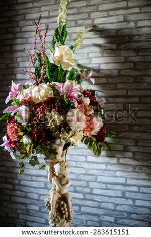 Still life with a beautiful bunch of flowers in vase - stock photo