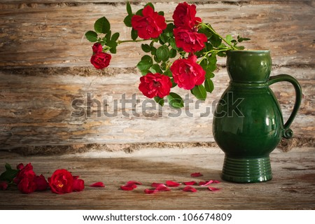 Still life with a blooming branch of rose - stock photo