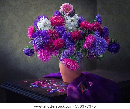 Still life with a bouquet of asters - stock photo
