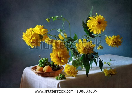 Still life with a bouquet of dahlias and apricots - stock photo