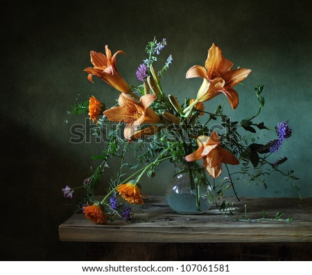Still life with a bouquet of lilies - stock photo