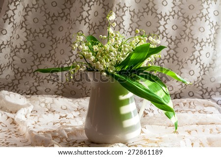 still life with a bouquet of lily of the valley - stock photo
