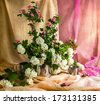 Still life with a bouquet of viburnum and hawthorn - stock photo