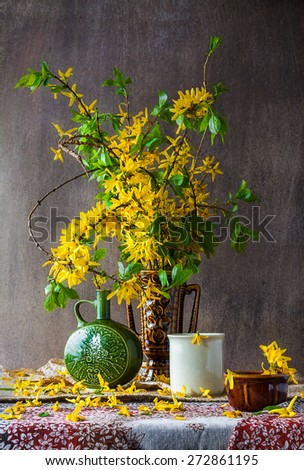 Still Life with a bouquet of yellow forsythia spring - stock photo
